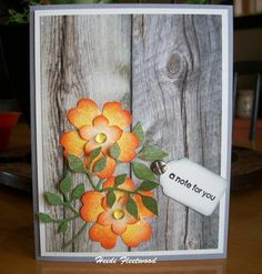 I really loved this challenge.  When I saw the picture, https://www.etsy.com/listing/221102467/16-wood-grain-pillow-cover-rustic-decor?ref=shop_home_active_9, I knew I had to make the card that's been in my imagination for weeks.  Was the first time using this flower set, they are pretty indeed.  Turned out great.  Added clear Robin's Eggs to center of bloom, leaves were a die cut and the brad is a phillips head screw.  I like the aged wood look, so I did not go with the Cedar. Thanks for a…