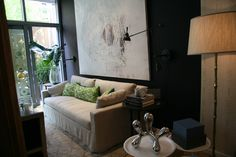 Antony Todd designed the great room, which featured gorgeous furnishings from Restoration Hardware and moody Farrow & Ball paint.