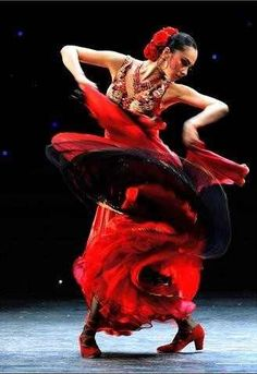 Watch a flamenco show in Madrid, Spain  Feel the vibrant, pulsating heart of Spanish culture when you attend a flamenco show in Madrid. Order a glass of sangria – red wine mixed with juice and fruit – while you enjoy the guitar music and watch the dancers twirl around the stage.