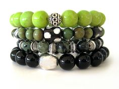 Amazing beaded stretch bracelets (4 in all!) featuring 10mm black agate beads, 10mm lime green limestone beads, 8mm seraphite beads, 7 mm green sandlewood beads, Kenya bone beads and pewter accent beads. A stunning handmade bracelet stack that can be worn stacked as shown for an arm party or for a more simple statement, wear bracelets individually. Sure to draw rave reviews every time you wear it!