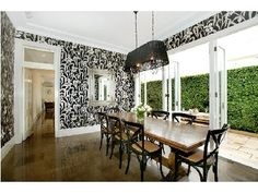 Love the table & chairs--Wallpaper and light look like they  belong in Regina's house from Once Upon a Time.