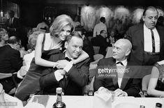 Nancy Sinatra hugs dad; Yul Brynner looks on.