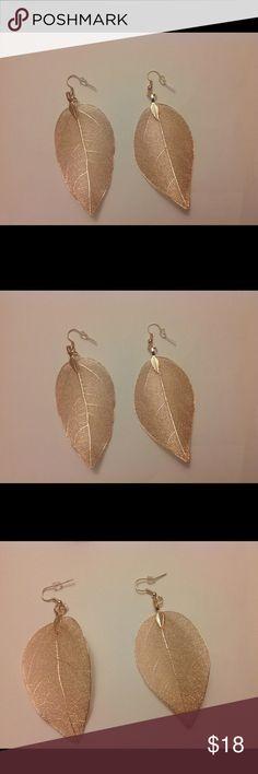 New rose gold color earrings leaf shape Delicate leaf earrings. Also available in gold color. Rose gold belt also available..see other listings. Jewelry Earrings