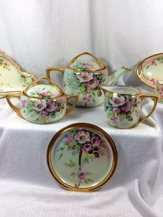 Welcome to A Thing of Beauty Vintage Finds 1900 - 1920s 9 Pc. Moss Rose Rosenthal Donatello China Tea Set & matching pieces, all artist signed - Beautiful gift Here's what I know: E state sale items.
