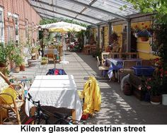 Denmark Cohousing Tour 1999 photo- Daydream! This is a glassed in street with lovely tables. If they can do it in Scandinavia, we can do it in Scandinavia, West Campus (Minnesota).