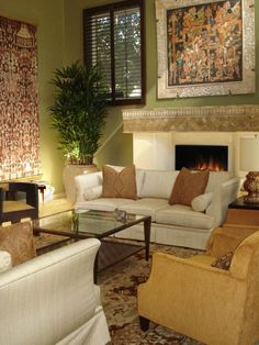 Infused with global style, this living room has exotic artwork and furnishings from Asia, Africa and India.