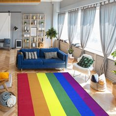 Enjoy this colorful rainbow flag rug to represent LGBTQ pride or to simply brighten up any room. #rugs
