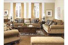 """The Porters Gate Oversized Chair from Ashley Furniture HomeStore (AFHS.com). Flowing with rich traditional beauty, the """"Porters Gate-Umber"""" upholstery collection features plush rolled arms and seating cushions all perfectly adorned with the deep finished showood to create a sophisticated atmosphere within any living area."""