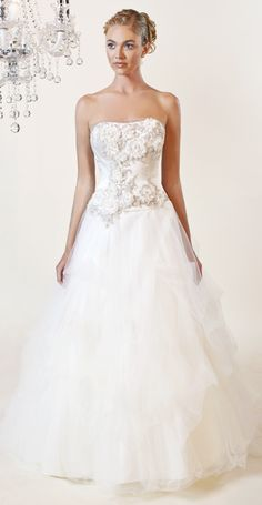 Winnie Couture...Aurella (3166)...Ball gown with tulle skirt. The bodice has floral appliques with Swarovski crystal.