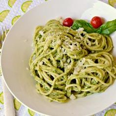"""Light Lemon Pesto Pasta - """"Light, yet full of flavor, this pesto is perfect tossed with hot spaghetti for a quick dinner. It is also excellent as a pizza sauce or smeared on hot French bread. It freezes well to preserve the bounty of summer basil.""""  I recommend tossing the pesto with hot pasta so the cheese sort of melts and coats each strand. You might want to reserve a ladle or two of hot pasta water so you can add a little while tossing if you want a saucier dish."""
