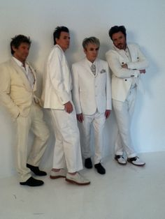 scandal in white... of course Roger has to go be different and wear cream!!!
