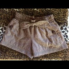 High waisted tweed shorts Precious high waisted tweed shorts. The perfect summer to fall intro shorts! Very flattering with an elastic waist and cute faux tie bow. Side pockets include a tortious button. Turquoise accent stitching at hem! Worn once. In perfect condition. Love these! Emphasis Shorts Skorts