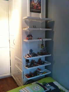 Ikea Algot Wall Upright with Shelves as Lego display solution. Used two side-by-side for even more shelf space. Will likely add more shelves to the top later on.