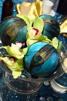 peacock feathers centerpiece wedding reception orchids
