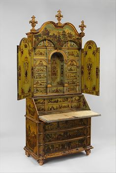 Desk (Secretary) Date: ca. 1730–35 Culture: Italian, Venice Medium: Pine; carved, painted, gilded, and varnished linden wood decorated with colored decoupage prints; mirror glass; the inside of the fall front lined with silk not original to the secretary