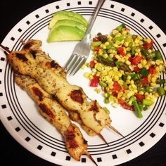 Chicken kabobs with a fresh corn,  asparagus, red pepper & green onion salad with a side of avocado.