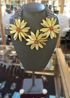 What better way to brighten up your wardrobe than this fab new Yellow flower statement necklace. Handmade using Swarovski crystals and beading. Available in store now only €110.00. Make sure you give us a ring or message us if you want us to pop one away for you. Only 3 left!!! They are flying! #azurejewellery #statementnecklace #yellowflowerbecklace #sunflowers #handmadenecklace Yellow Flowers, Handmade Necklaces, Sunflowers, Swarovski Crystals, Beading, Jewelry Making, Jewellery, Pop, Store