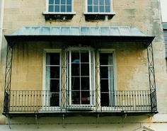 The Georgian architecture of Bath is adorned with many and various styles of these attractive features. Balconies and balconettes are often used to decorate a facade or frontage. Georgian Buildings, Georgian Architecture, Modern Georgian, Georgian Homes, Balcony Window, Balcony Railing, Door Canopy Designs, Metal Window Boxes, Juliet Balcony
