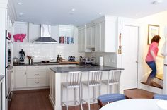 Where I Cook: Abby Ruettgers of Boston's Farm & Fable - love the white subway tile, shaker cabinets, soapstone counter and giant pink pig. Shaker Cabinets, White Cabinets, Small White Kitchens, Modern Kitchens, Dream Kitchens, Old Apartments, Functional Kitchen, Open Plan Kitchen, Kitchen Ideas
