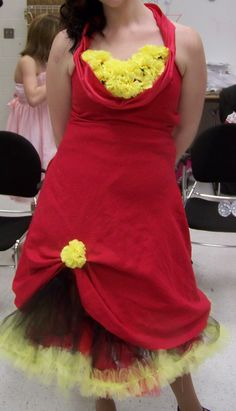 "Cha-cha's dress was a thrift store dress that got a ""shelf"" bust line made of the hem cut off of one of the longer prom dresses when we shortened it.  We glued Dollar Tree carnations to a piece of felt and then sewed them on (always trying to ensure the dresses can be used again for other things!)"