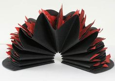 Inferno : Dante's nine circles of hell by Helen Malone. 2006. Quarter circle book. Ten circular pages each containing a linocut inserted into each folded page. Canson paper and card, Japanese paper and ink. A sculptural interpretation of Dante's journey down through the nine circles of sinners into the depths of hell derived from The Inferno. 15 cm x 15 cm x 8 cm. Edition of 3.