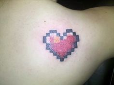 It's an 8 bit heart on my right shoulder blade. I've loved video games ever since I was introduced to them by my brother. From Pokemon to Zelda, I've played them all. Plus, I LOVE 8 bit music. Probably the coolest tattoo on my body, by far.  Done at Full Moon Tattoo in Illinois by Joe.