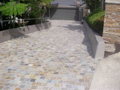 Eco Outdoor provides the best in natural stone flooring including pavers, tiles and more. Find resources, request a sample or contact a rep today. Driveway Edging, Cobblestone Driveway, Tile Suppliers, Natural Stone Flooring, 1930s House, Landscaping Images, Facade House, House Facades, Outdoor Flooring