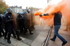 Nantes, France Protesters taunt riot police with flares during a demonstration against police brutality