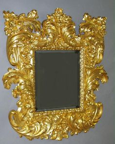 A Very Fine Palatial Italian Baroque Style Early 19th Century Vigorously Carved Florentine Gild-Wood Mirror Frame. Circa: 1820. All gilding is 24 carat gold leaf. Great quality and hard to find mirror frame