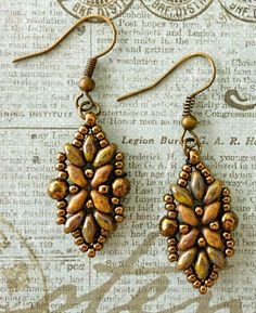 UPDATED EARRINGS   I blogged about these earrings back in February. I'd been meaning to remake them because I wasn't happy with the way t...