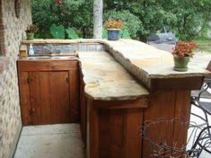 outdoor wood bar whimsical slate stone and wood outdoor bar by Portable Outdoor Bar, Outdoor Wood Bar, Outdoor Decor, Outdoor Stone, Outdoor Kitchen Countertops, Outdoor Kitchen Bars, Outdoor Bars, Outdoor Kitchens, Bar Countertops