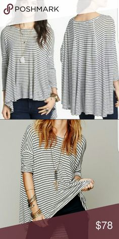 Free people circle in the sand tee Black and white stripped. Tagged xs/s but can fit up to a xl. Excellent condition. Free People Tops
