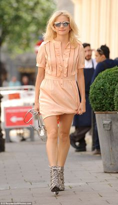 Strutting her stuff: Pixie Lott  was once again dressed to impress when she took to the streets of London on Saturday ahead of her evening performance in Breakfast At Tiffany's