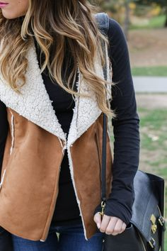 Love this shearling vest.