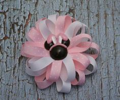 A personal favorite from my Etsy shop https://www.etsy.com/listing/270463613/minnie-mouse-hairbow-pink-white-flower