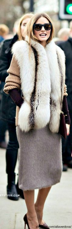 Love fur. However I just noticed her skirt is also fur which in person I think would be a bit much wool might be better.
