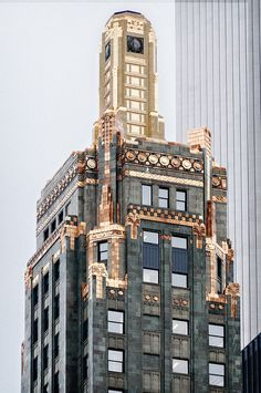 Carbide & Carbon Building (1929), crown 7/8, 230 N Michigan Ave, The Loop, Chicago. 37-floor Art Deco skyscraper by Daniel and Hubert Burnham, sons of Chicago architect and city planner Daniel H. Burnham (1846-1912) • polished black granite base trimmed with black marble and bronze • tower sheathed in deep green terra cotta.