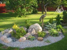 Ein Runder Steingarten Mit Grauem Kies Und Grünen Pflanzen