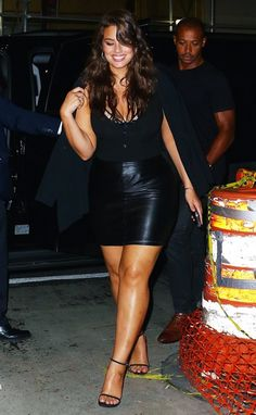 Ashley Graham wears a black leather miniskirt with a bodysuit.