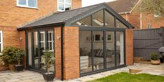 Solid roof sunrooms from Wessex Windows in Winchester come in various styles, colours and finishes. Get your free quote today! Solid roof sunrooms from Wessex Windows in Winchester come in various styles, colours and finishes. Get your free quote today! House Extension Plans, House Extension Design, Roof Extension, Extension Ideas, Extension Google, Orangerie Extension, Conservatory Extension, Orangery Extension Kitchen, Modern Conservatory