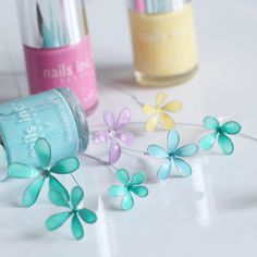 Nail varnish / polish Flowers - I thought I'd have a go at making mini flowers with nail polish and wire. No glue just wire and nail varnish. Any type of polish worked but these Nail Inc pastel colours are beautiful.