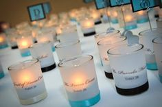 These Escort Votive Candles with Blush Pink, Black, and Ivory Ribbons