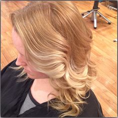 Balyage styled with waves to enhance color