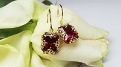 Design contest earrings, rubies in yellow gold, by David Klass Jewelry.