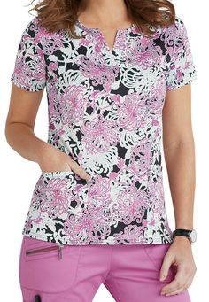 The Blossom Henley top stuns with an allover floral print in crocus, black, and white. The soft, stretch fabric provides serious comfort throughout your hectic workday. Two spacious pockets and an always handy cell phone pocket give you plenty of places to store your accessories.