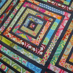 Beautiful Scrap Quilt...would make a cool spiral design too.