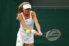 Daniela Hantuchova of Slovakia eyes the ball during her ladies' singles first round match against Jamie Lee Hampton of USA on day one of the Wimbledon Lawn Tennis Championships at the All England Lawn Tennis and Croquet Club on June 25, 2012 in London, England