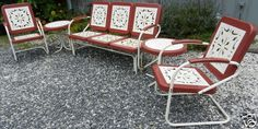 Vintage Mid Century Metal Lawn Patio Glider Chairs Tables a Complete Set $399.00. My grandmother had this same glider on her porch.