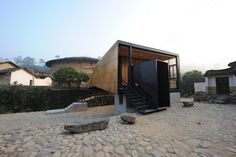 Built by Li Xiaodong Atelier  in Xiaoxi, China with date 2009. Images by Li Xiaodong. The Bridge, the School, the Playground, the Stage  Located at a remote village, Fujian Province in China, the project...
