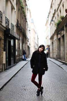 Pairs street style // Love the maroon pants and furry black jacket